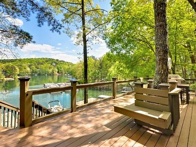 Lake view from deck with glass balusters and built in seating.
