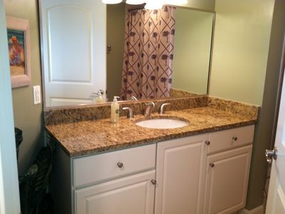 Hall Bathroom with Tub/shower combo with granite countertop vanity
