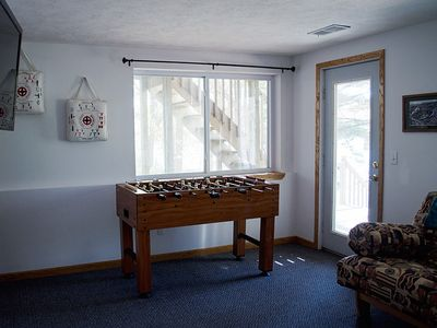 Lower lvl sitting room-hd tv, foosball table and a lake-view deck right outside