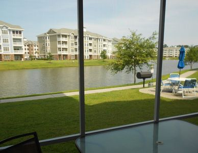 Magnolia Pointe condo rental - Grill just steps from the back door !/2 mile path around lake
