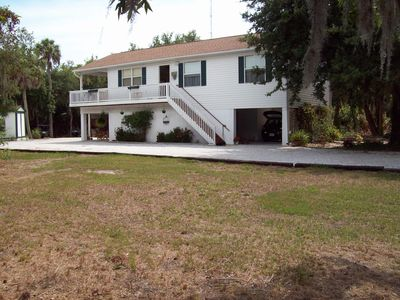 Great Keywest style house on 5 beautiful florida acres. Main living is upstairs.