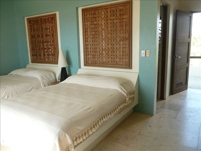 Guest suite with 2 queen beds and private bathroom