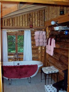 bathroom with claw foot tub and Fr. shower
