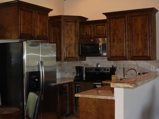 Pinetop condo photo - Brand New Gourmet Kitchen Travetine Tile, Stainless Steel Appliances, Granite