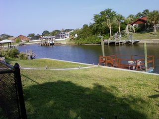Palm Coast house photo - View of the backyard, the dock and down the canal, watch the fish jump!