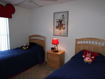 Micky and Minnie themed bedroom with twin beds.