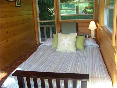 comfortable futon in cypress sunporch for added guest.