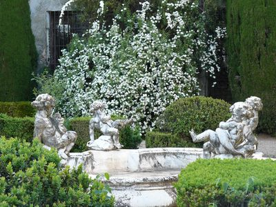 The white marble Italian fountain. Front garden