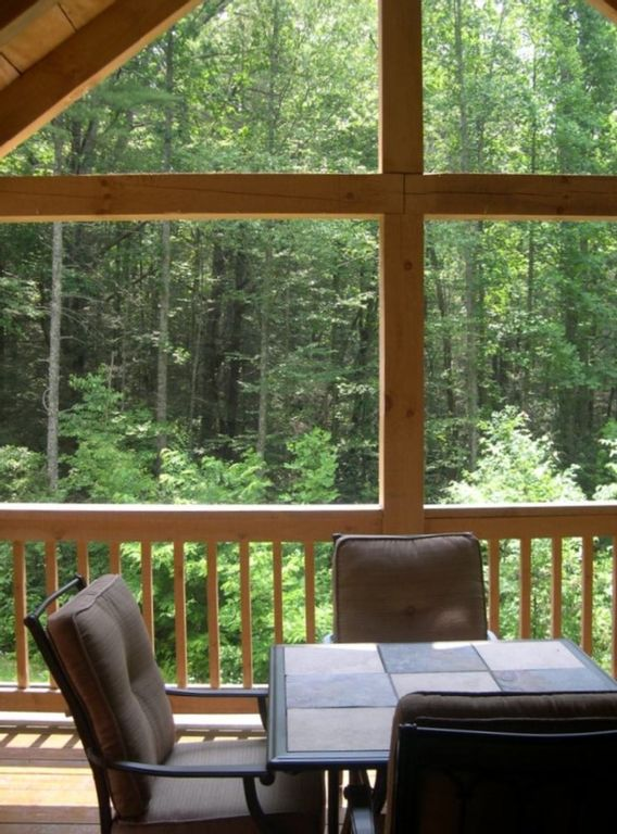 Enjoy a private view of the woods from the covered back deck