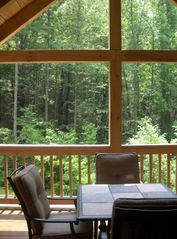 Cashiers house photo - Enjoy a private view of the woods from the covered back deck