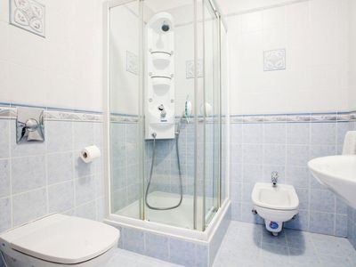 Bathroom in Magdalena with massage shower, bidet and toilet