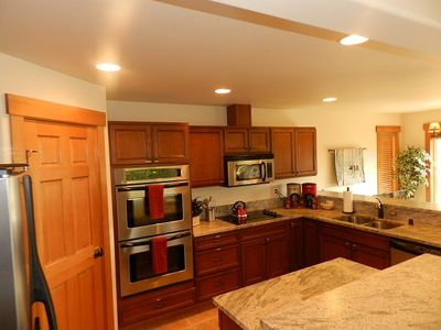 Main Kitchen, double wall ovens, side-by-side stainless fridge/freezer, pantry