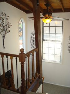 Large open stairs with open beams and wood/rod irons rails & iron artwork.