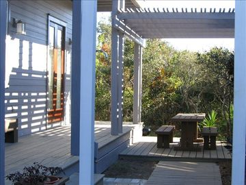 Side Deck w/ Private Outdoor Dining Under Shaded Trellis, Landscaped Foliage