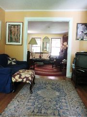 Great Barrington house photo - first living room, looking into second living room