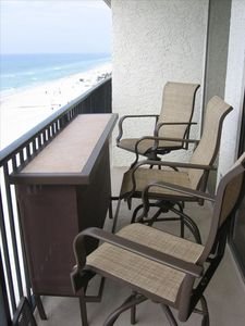 Have your meals and drinks at the balcony bar overlooking the beach!