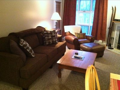 New couch and leather chair with ottoman