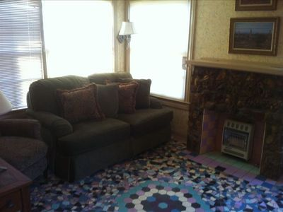 Separate tv room/ den with mosaic tile floor