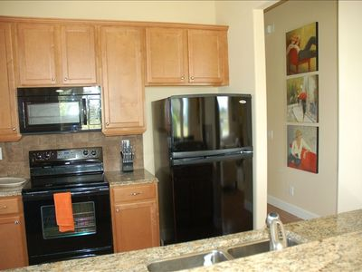 Fully equipped kitchen| Marble countertops | lots of dishes, utensils, glassware