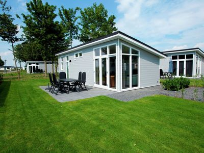 Carefully furnished chalet on recreation park Het Esmeer with many water sports facilities.
