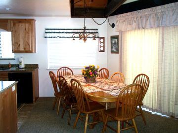 The Dining Area includes a large Oak Table that can seat up to 9.