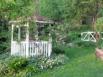 Asheville cottage rental - Sit and swing peacefully in the gazebo by the stream in the soft sunlit garden.