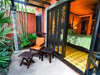 Tamarindo house photo - Tropical lush outdoor seating area off master bedroom perfect for relaxing...