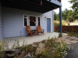 Estes Park condo photo - Wild Flower porch with wild flowers and views of mountains