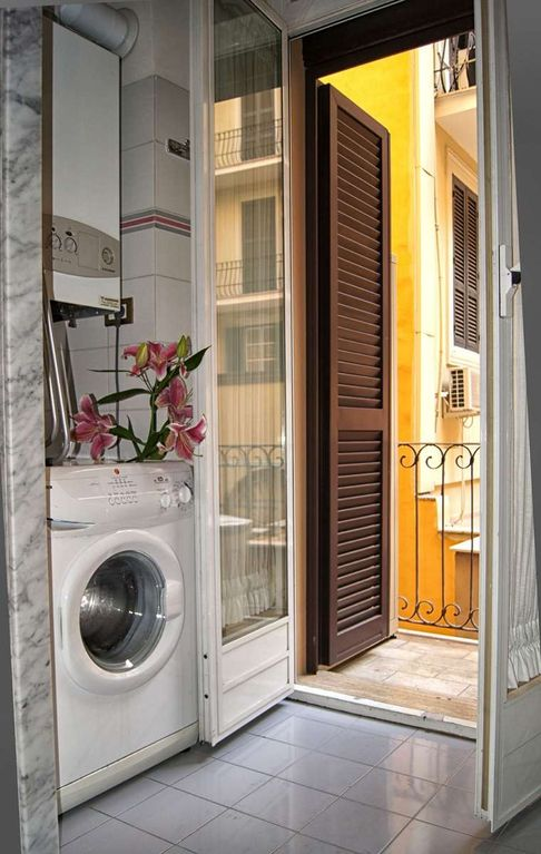 bathroom with washing machine and balcony