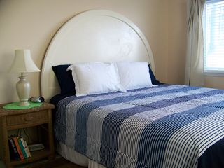 Carolina Beach condo photo - Comfortable king-sized bed; cottage wood floors.