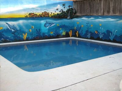 Relax by the beautifully painted pool area!