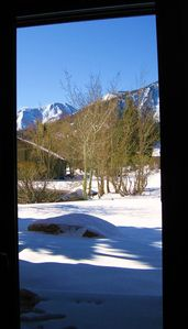 Winter view out sliding glass door to pond and Sherwin Range