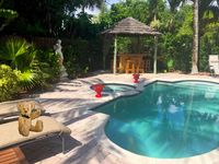 Cool off in the pool and enjory this backyard tropical paradise.