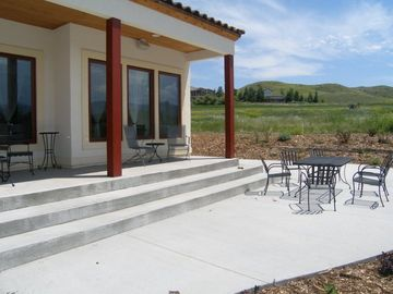Sheridan house rental - The back patio overlooking the ninth hole of the Stag course.
