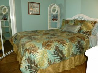 Galveston condo photo - The bedroom features wicker furniture, a queen bed and a TV too