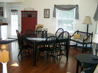 Dining Room - Table seats 8 right off kitchen, also working fireplace