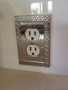 Silver designer switch plates - why not? we appreciate beauty