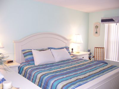 Cocoa Beach condo rental - Master bedroom with King bed, flatscreen TV, make-up stand and walk-in closet.