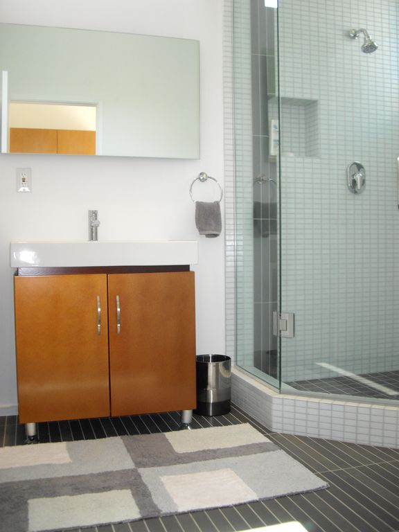 Casita bathroom with glass enclosed shower.