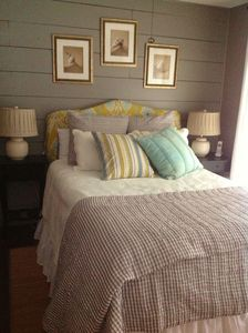 Beautiful master bedroom with queen size bed and screened porch access.
