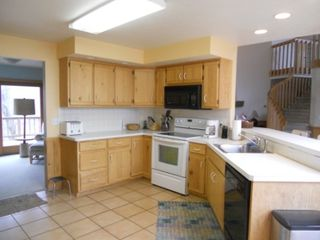 Jacksonport house photo - Kitchen Area with Snack Bar and all the cooking and serving supplies you need