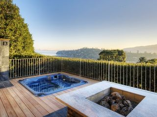 Fire pit, hot tub and shower with the SF Bay in the background. - Tiburon house vacation rental photo