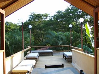 Tamarindo studio photo - Upstairs sun-deck has cushioned chez longes for sunbathing.