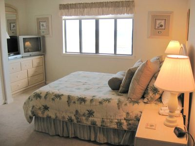 A wonderful queen bed in the master bedroom with a fantastic ocean view!