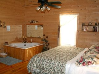 heart shaped jacuzzi- king sized bed - Muddy Pond cabin vacation rental photo