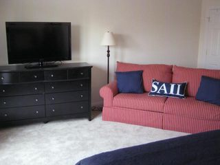 Seaside Heights condo photo - Queen bedroom suite with flat screen and couch. View of pool.