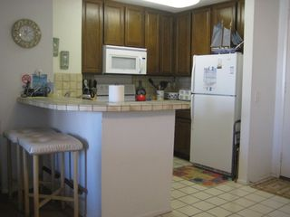 Oceanside condo photo - Kitchen with full array of cookware, dishes, glassware and utensils
