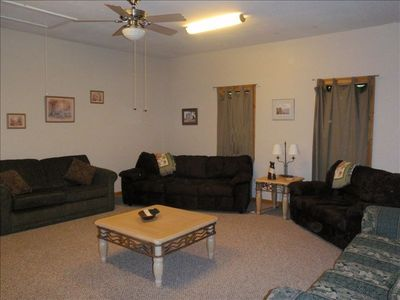 The spacious familyroom, has a door for privacy, and can sleep up to four people