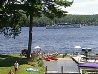Our beach area with the Mt Washington Boat going by. - Alton cottage vacation rental photo