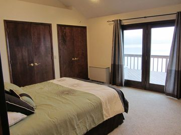 Main Master Suite with direct deck access and amazing lake views